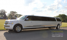 14 passenger limo Lincoln Navigator with sun glare