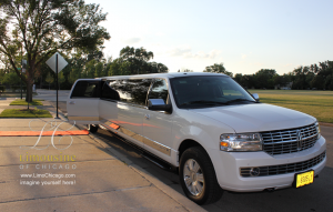 14 passenger limo with red carpet near church