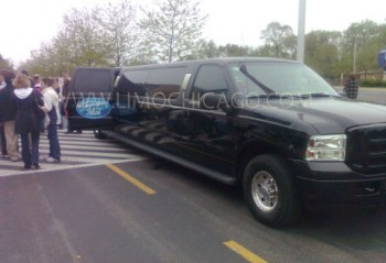 Limo Chicago 14 passenger Ford Excursion with American Idol insignia on the open door