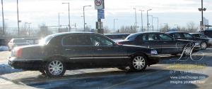 3 Town Cars in the airport parking lot of O'Hare International Airport
