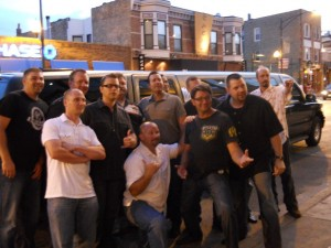 Bachelor party guys in front of SUV stretch limousine at Chicago bar